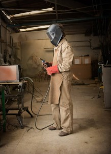 man in a welding suit