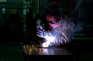 Welder working on a metal plate