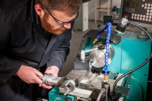 Man wearing glasses using tools